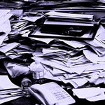 piles of paper on a desk